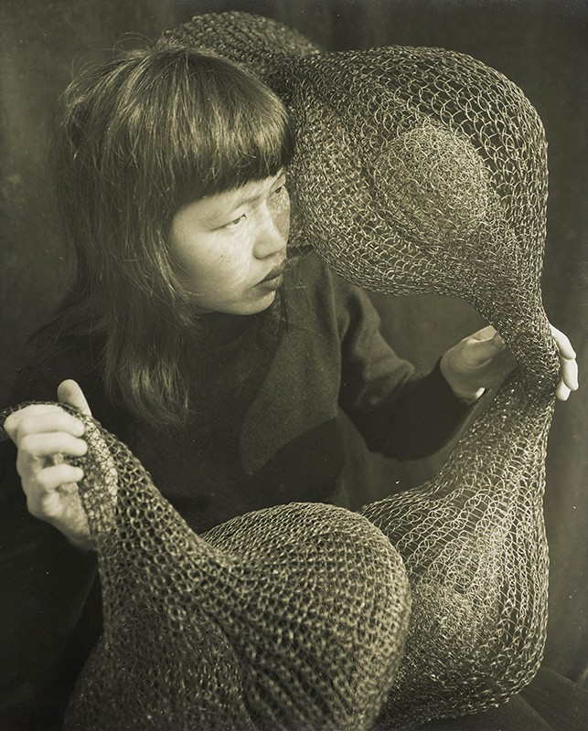 Untitled (Ruth Asawa holding a looped wire sculpture), 1952