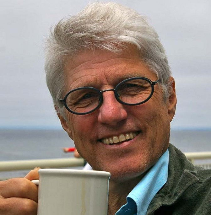 Portrait of the artist wearing glasses and drinking a cup of coffee