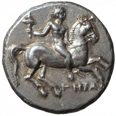 coin with man and torch