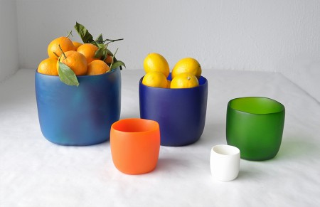 Colorfully modern bowls filled with citrus fruits