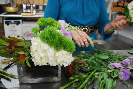 White and green flowers are arranged in a floral display