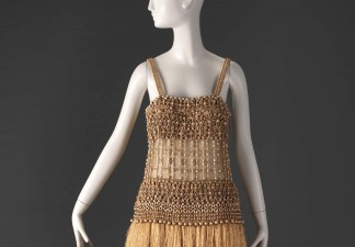 Yves Saint Laurent, evening dress, 1967. Beige silk and golden brown raffia; applied wood and brass beads. Fine Arts Museums of San Francisco, gift of Mrs. John N. Rosekrans Jr., 2012.42.138