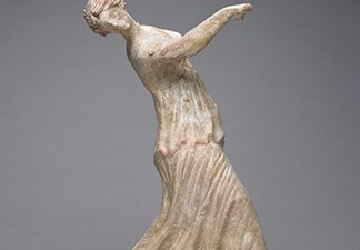 Dancing woman figurine