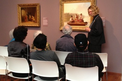A docent leading a tour in the galleries