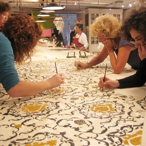 Isabelle de Borchgrave and studio collaborators at work on a piece inspired by A
