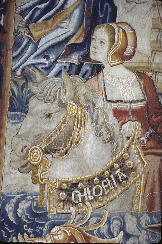 "A woman on a horse wearhing a banner stating the name ""Chloelia"""