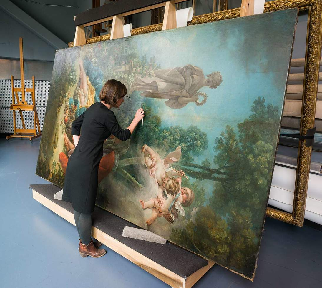 "Boucher's ""Vertimnus and Pomona"" undergoes study in the Museums' paintings conservation lab."
