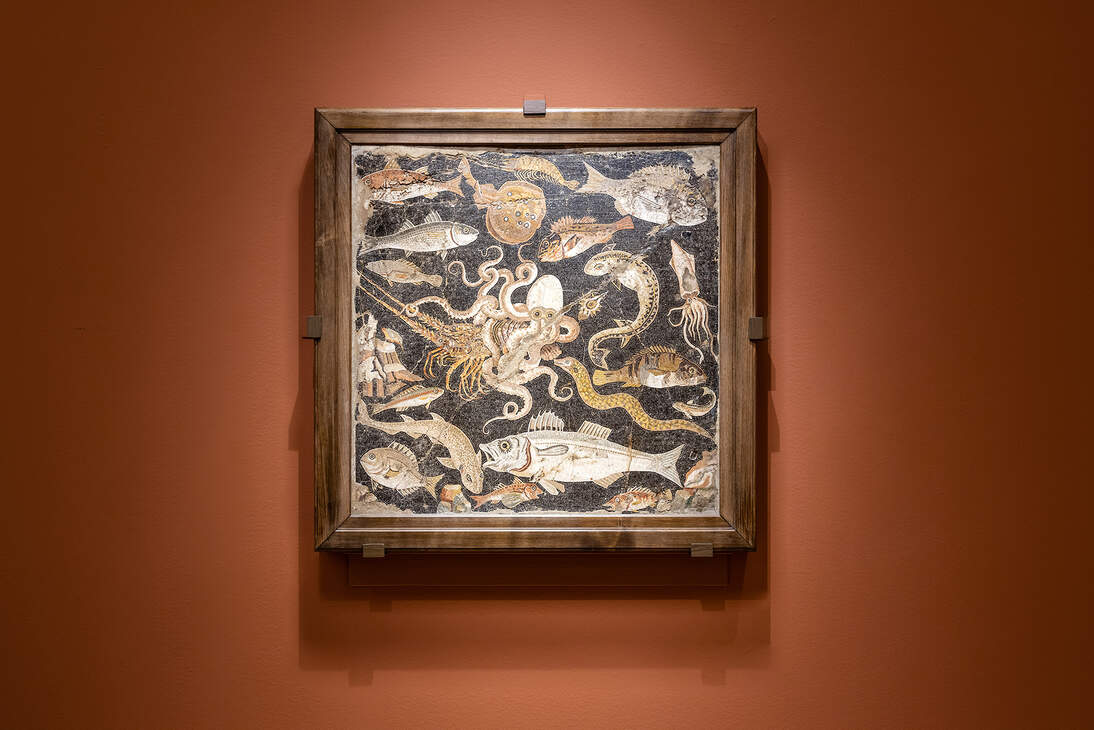 mosaic from Pompeii hanging on a wall