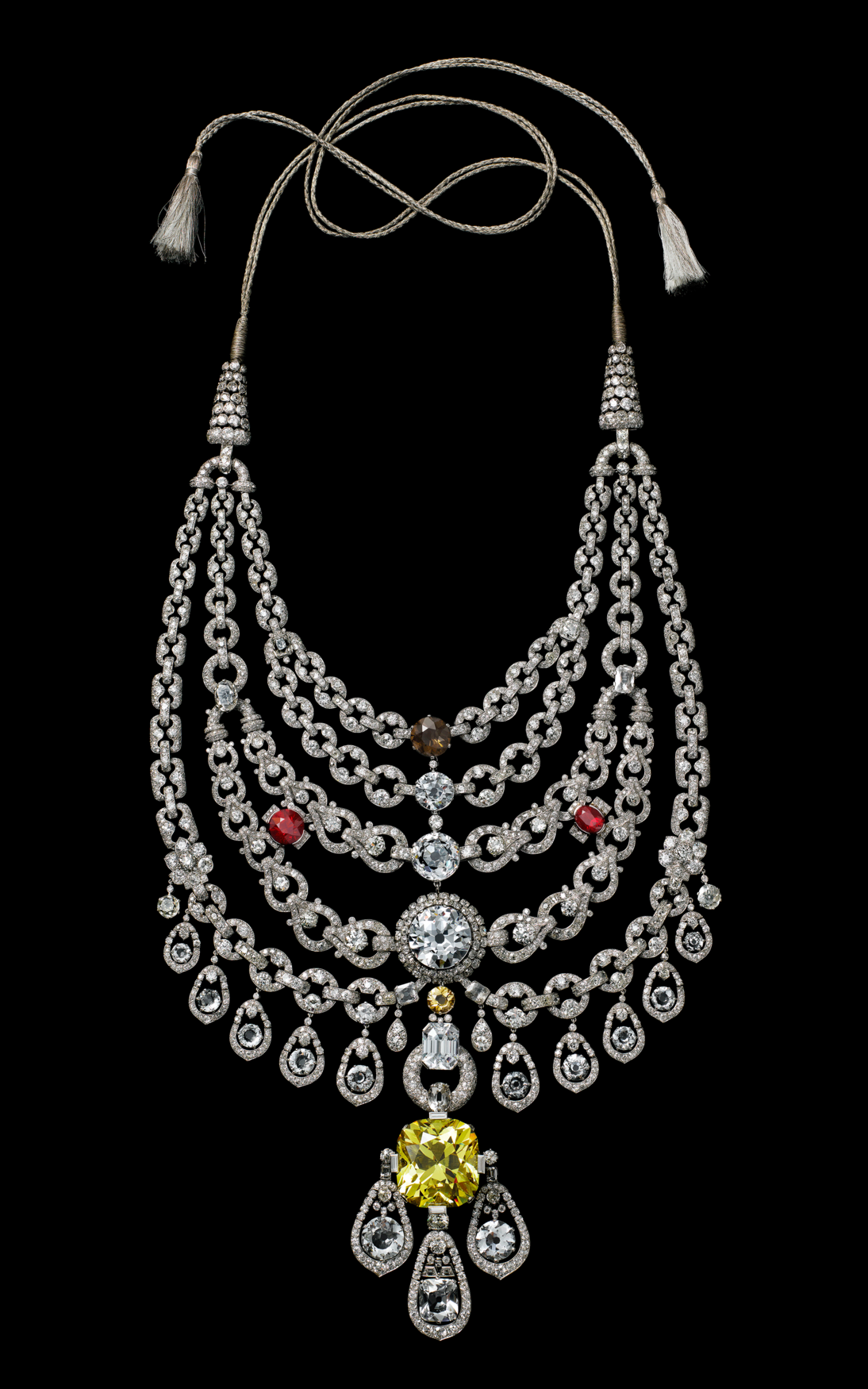 Necklace, Cartier Paris, special order, 1928. Platinum, old- and rose-cut diamonds (chain and links), one cushion-shaped yellow zirconia, four white zirconias, thirteen white topazes, two synthetic rubies, one smoky quartz, one citrine