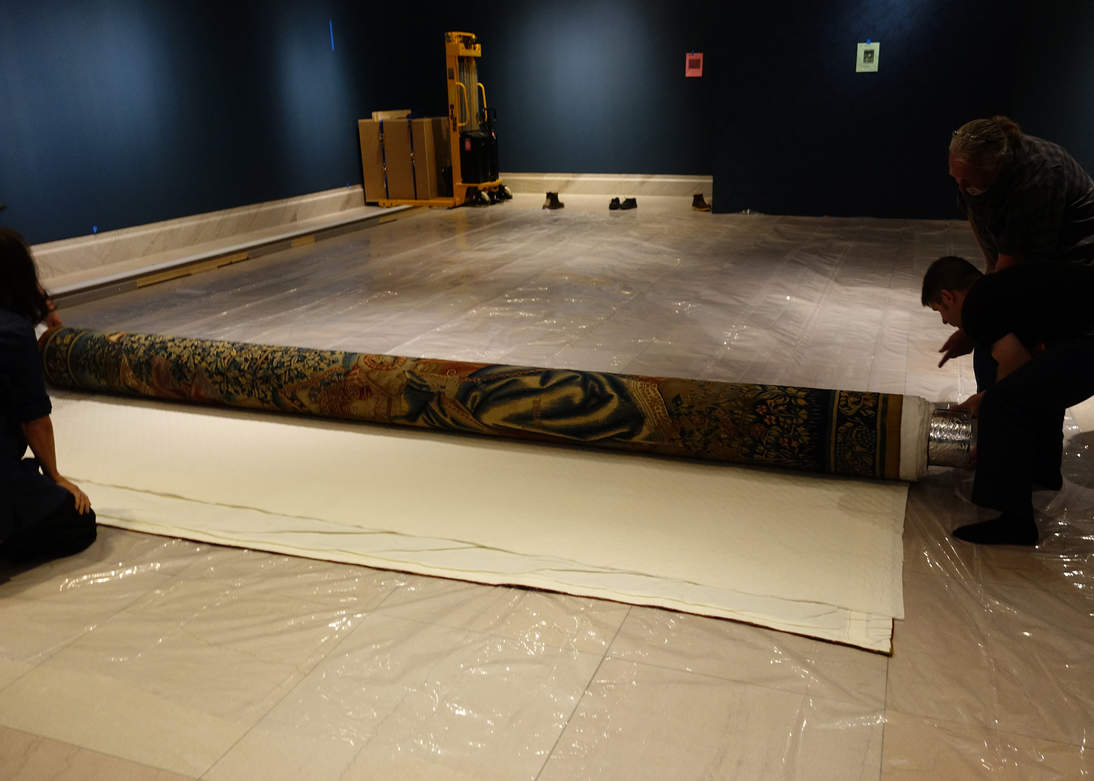 """The Combat of the Vices and Virtues"" tapestry was slowly unrolled in the exhibition galleries."