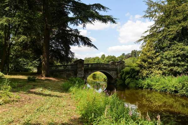 James Paine's Roman Bridge of 1770 in Capability Brown's Temple Wood, a pleasure garden created from 1765 at Weston Park, Shropshire